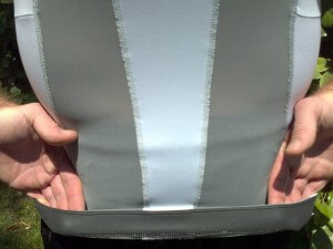Lower inner foam-like band located at rear of shirt keeps it in place