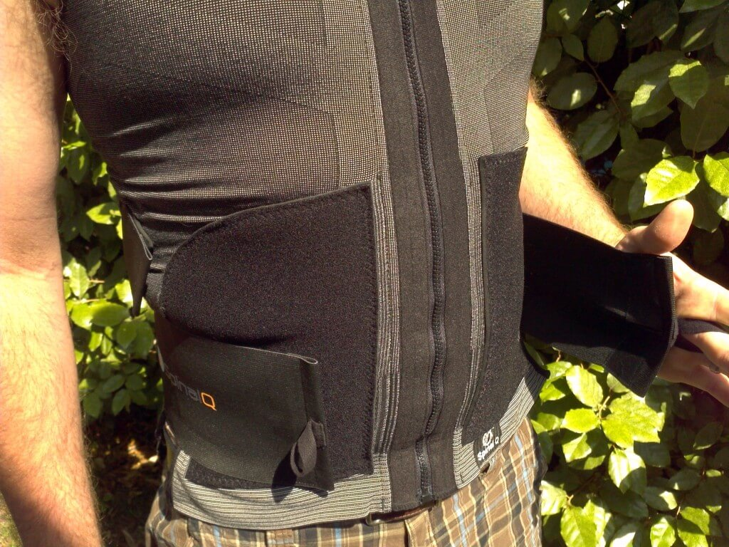 After zipping up, secure the lumbar strap on each side