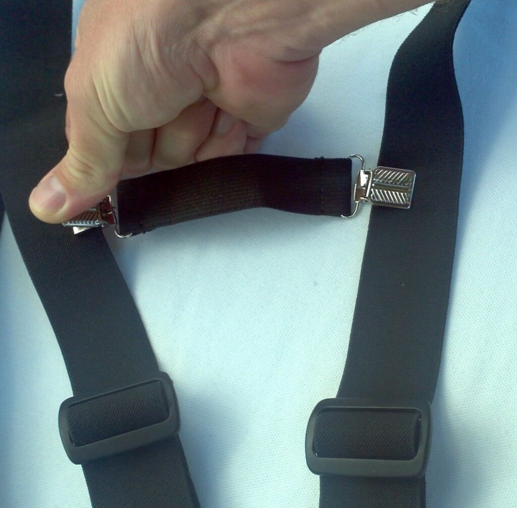 Fasten strap between shoulder straps