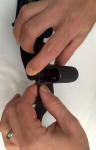 Use the slide to adjust the tension strap to the width of your chest
