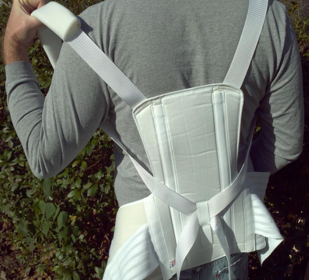 Feed arms through the shoulder straps
